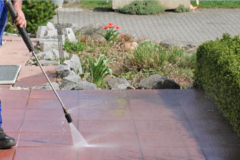Allen's Lawn Service pressure washing a patio in Lexington, KY.